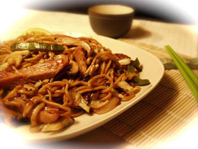 thick stir fried noodles and vegetables with your choice of